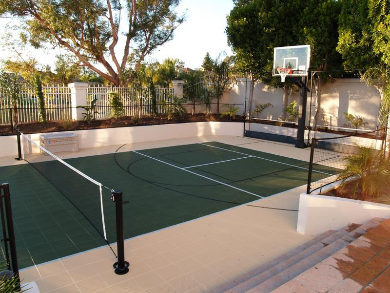 Backyard courts home gyms sport court of st louis for Building a half court basketball court