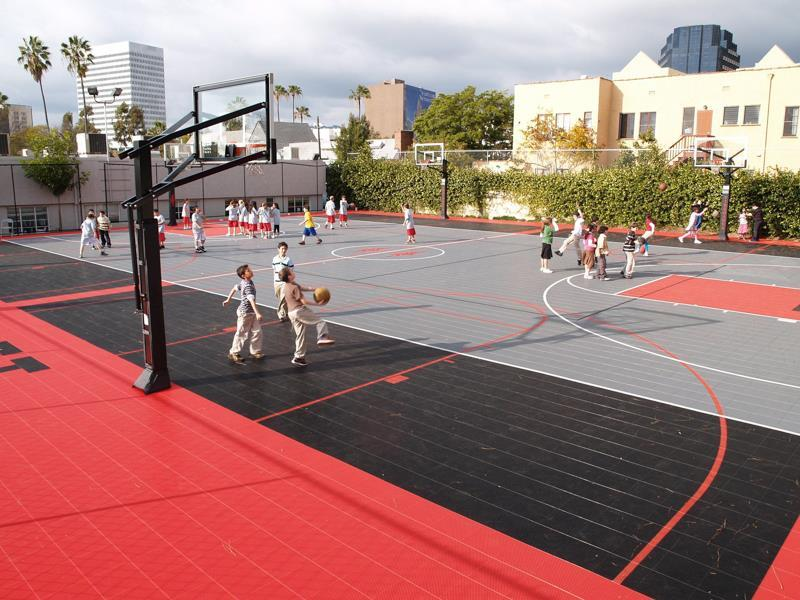 Backyard indoor and outdoor basketball courts sport court for Backyard sport court